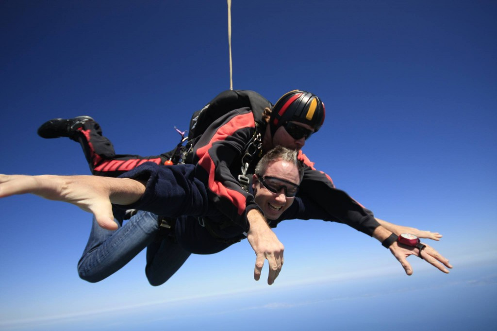 Bret Parker went skydiving this year to raise money for the Michael J. Fox Foundation. Parker participated in a study earlier this year about whether a wearable tracker could effectively measure the severity of tremors caused by Parkinson's. (Courtesy of Bret Parker)
