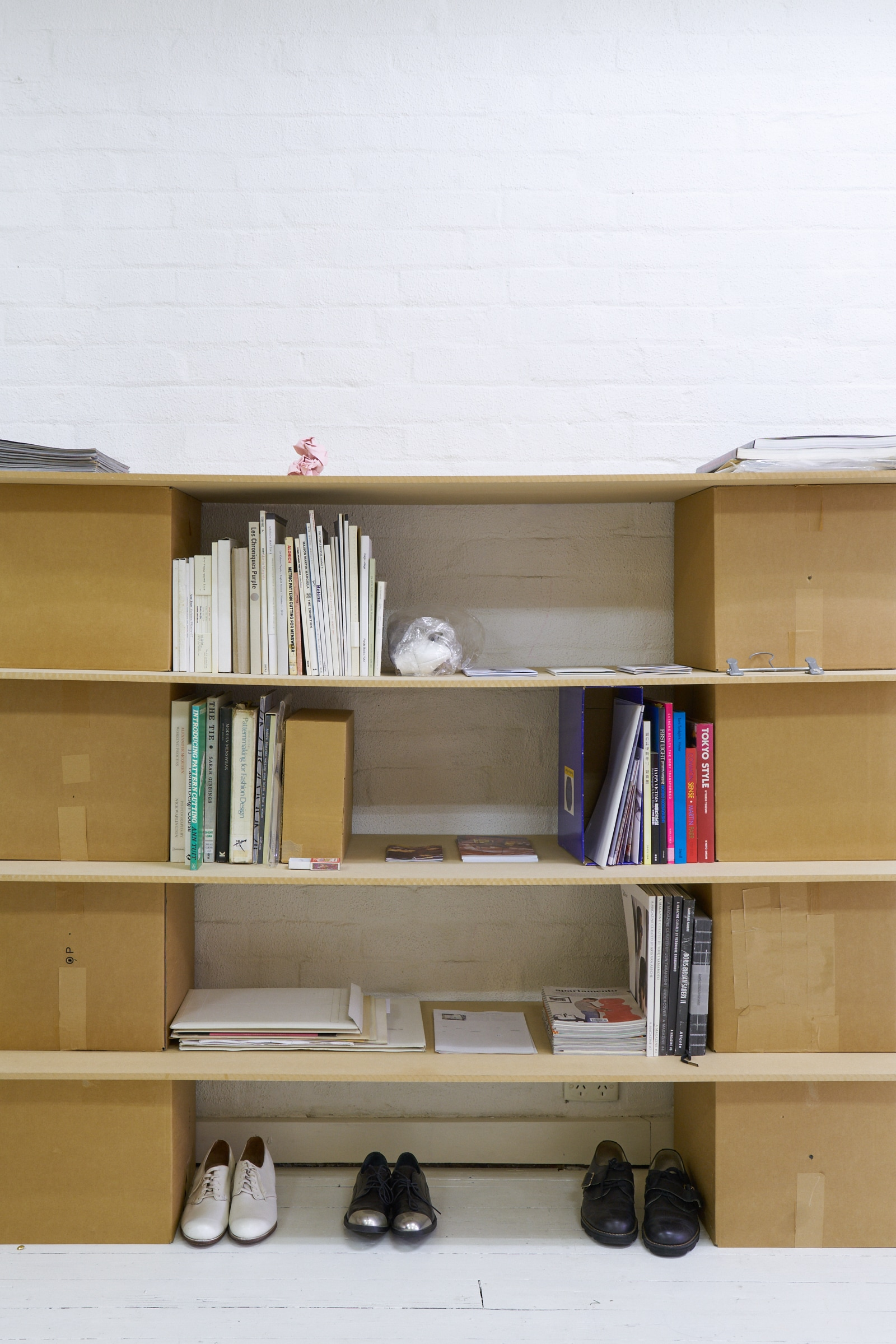 a flat shop's bookshelf housing Jennifer Mathews' hanger.