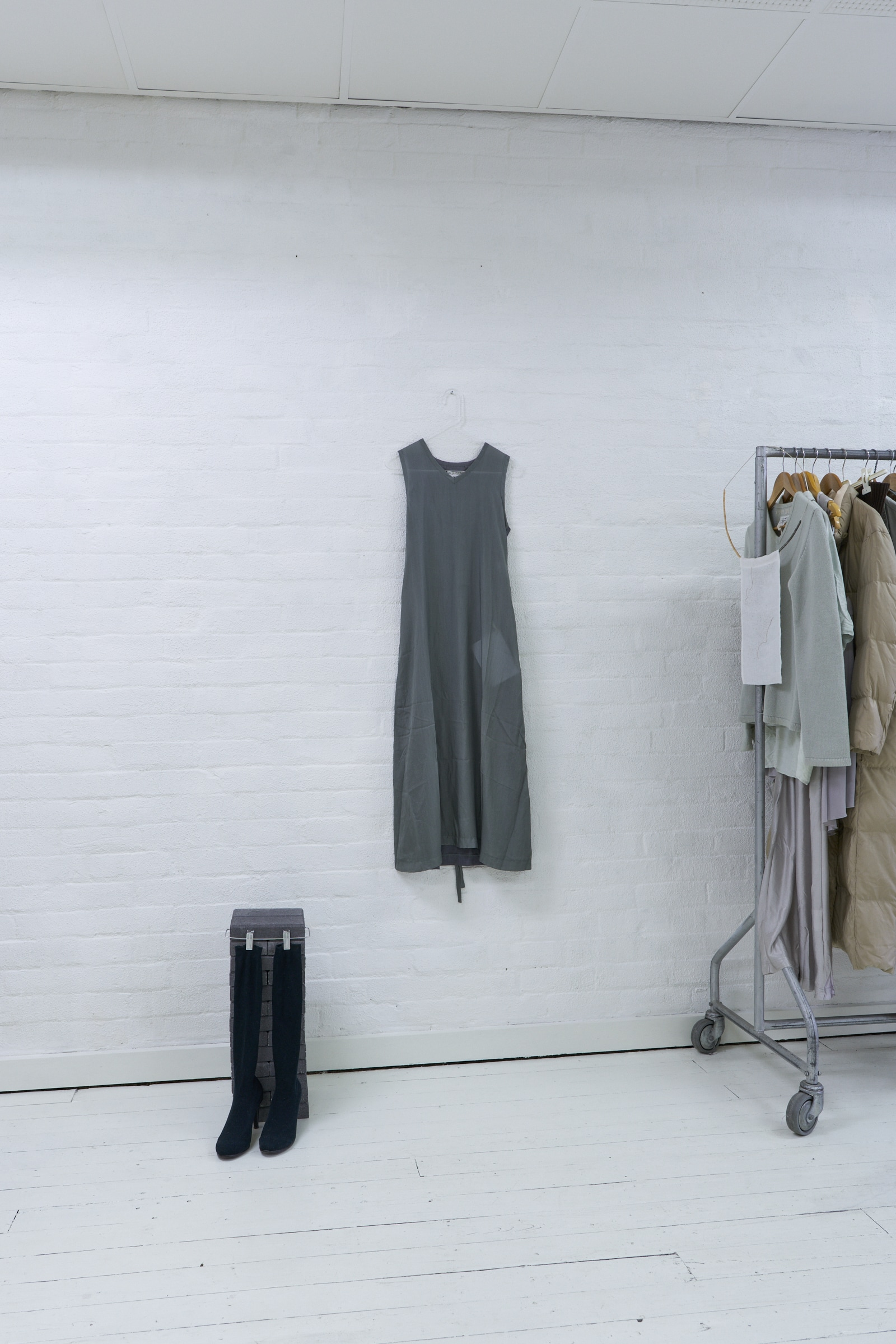 left to right: Eleanor Amor,  Shoe and sock stand,  2019. Brick and metal.  Iko Iko,  Clear Hanger,  2019. Clear plexi.  Lilly Buttrose,    A hanger: designed only to hang my practice illustrated in four techniques , 2019.