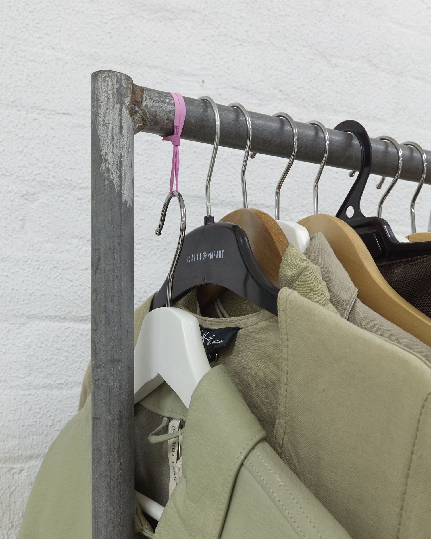 Christopher Arblaster,  Variable height hanger (depending on weight of garment hung) , 2019. Wood, metal, rubber band.