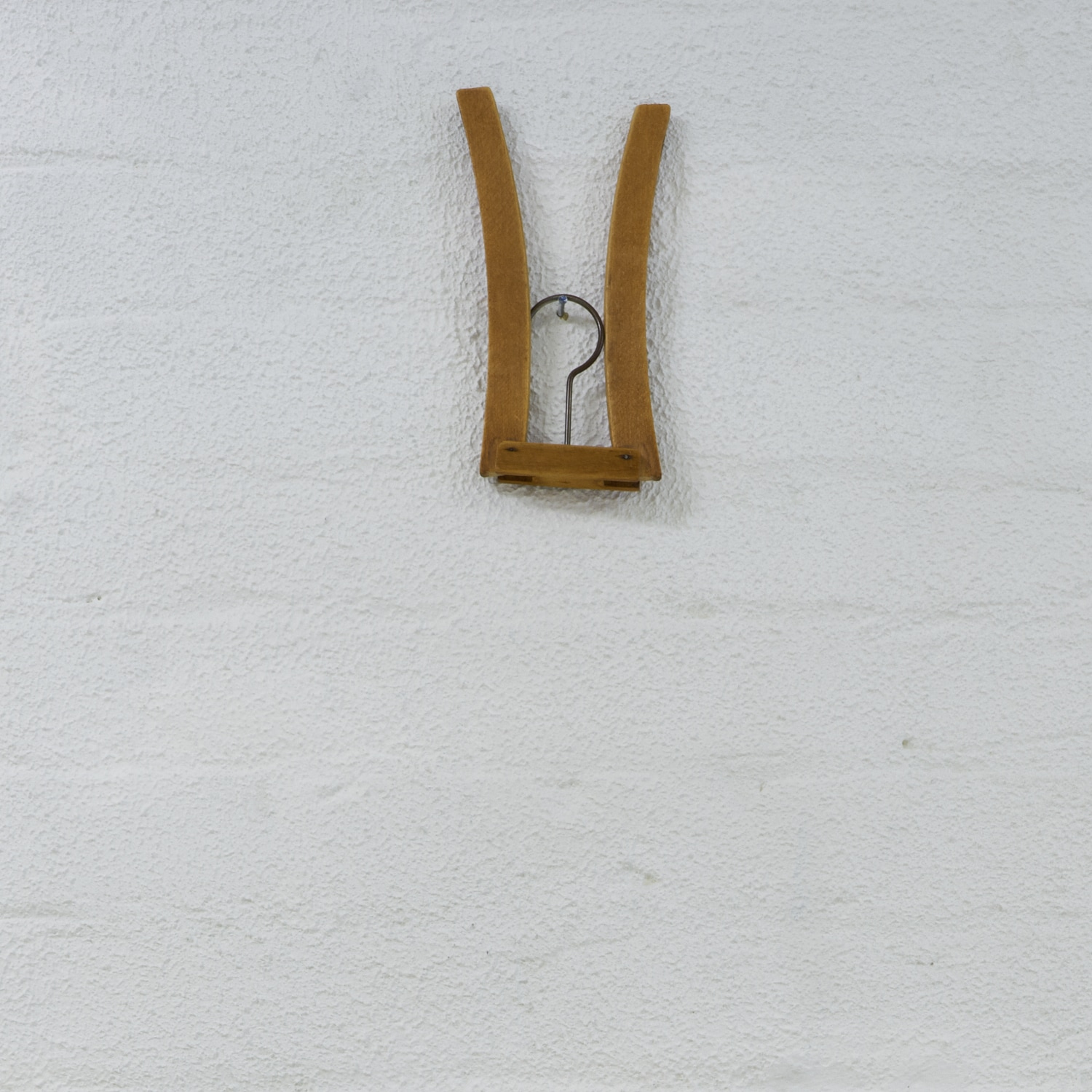Bridget Currie,  A hanger from my collection  (folding wood hanger), date unknown, Lithuanian. Wood and metal.