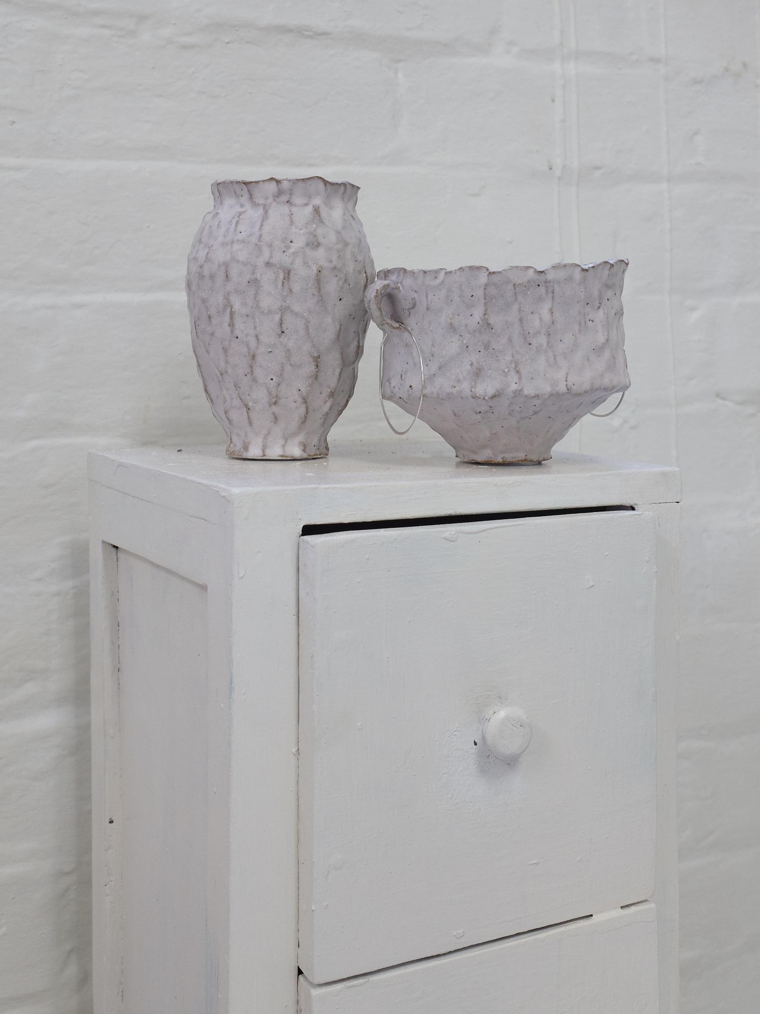 Connie Augoustinos,  Handled vessel  and  Vessel  2019. Stoneware, matte glaze.