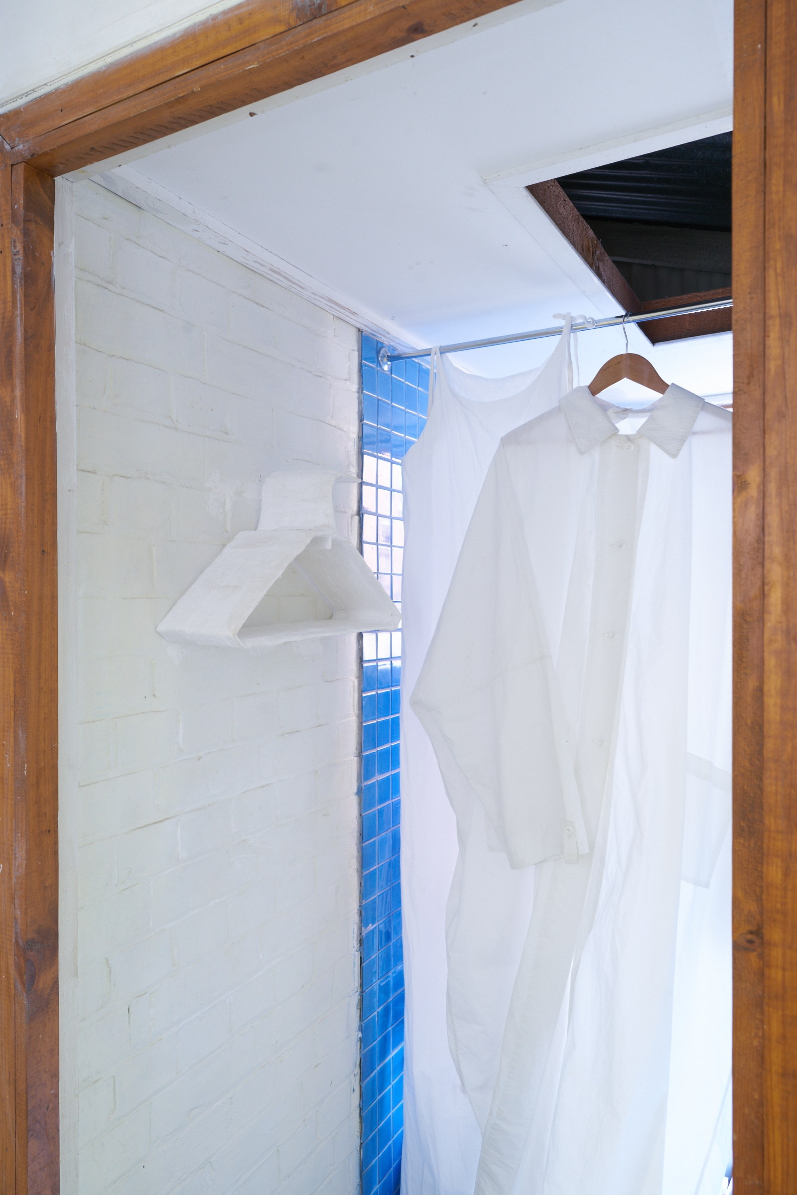 left:  Alexandra Sideris,   Storeroom supply 2,  2019.  Cardboard, plaster bandage.   right: two garments from Cloister Workrooms (previous endeavour by a flat shop members) 2017 exhibition ' Clothes for the Home'