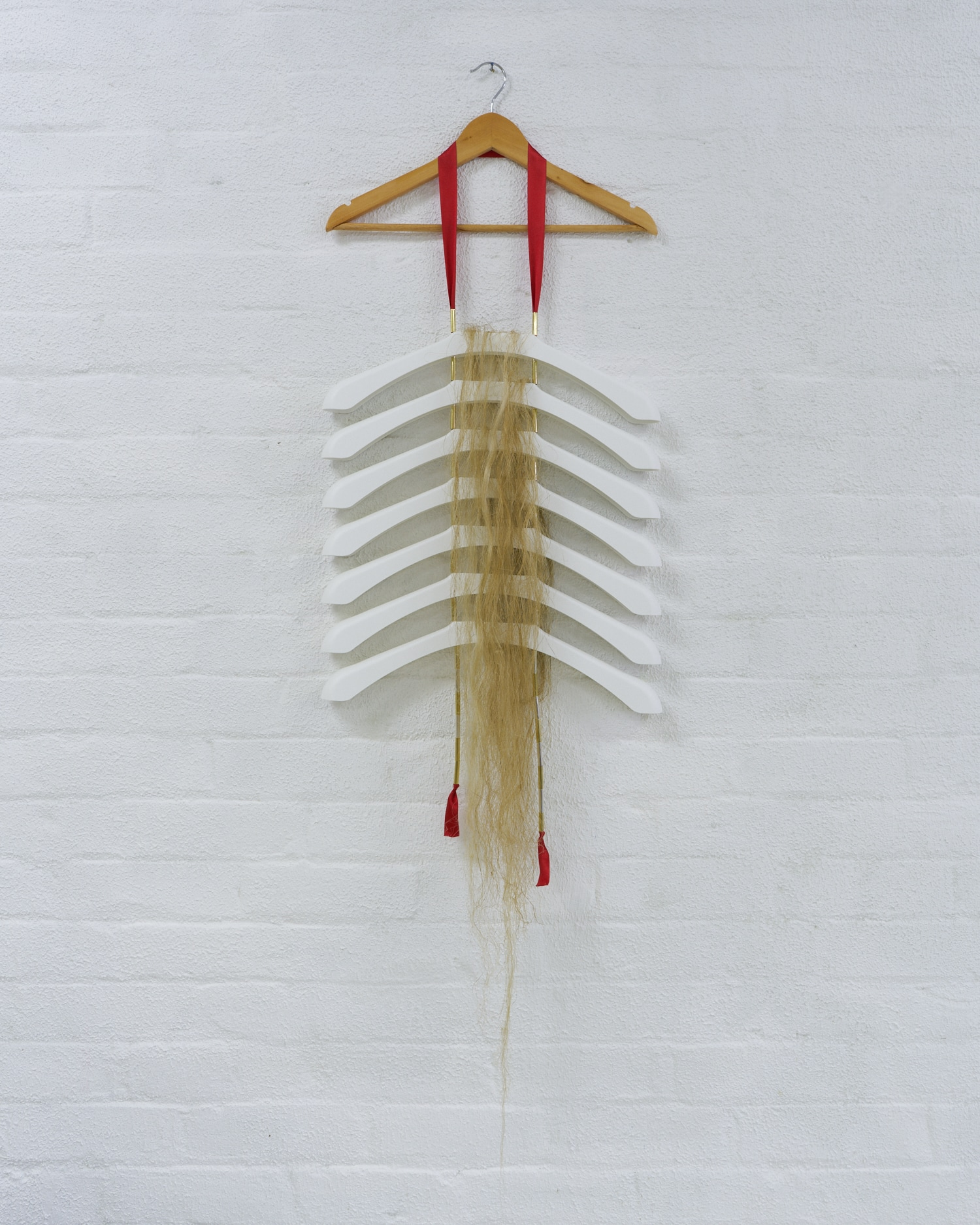 Matt Huppatz,   Adam, 2019.   Injection-moulded plastic (IKEA Bumerang), ribbon, metallic tubing, hemp fibre.