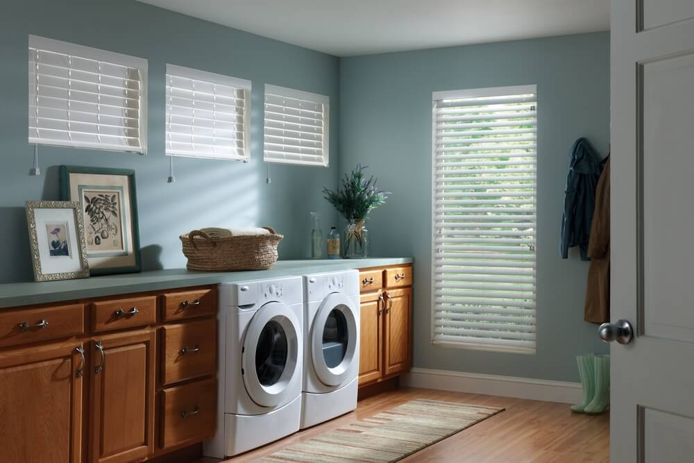 "2"" Faux Wood Blinds    Looking for a budget-friendly alternative to shutters? Faux wood blinds with tassels are a great choice in this laundry room. Their moisture resistant polymer finish make them idea for high humidity rooms."