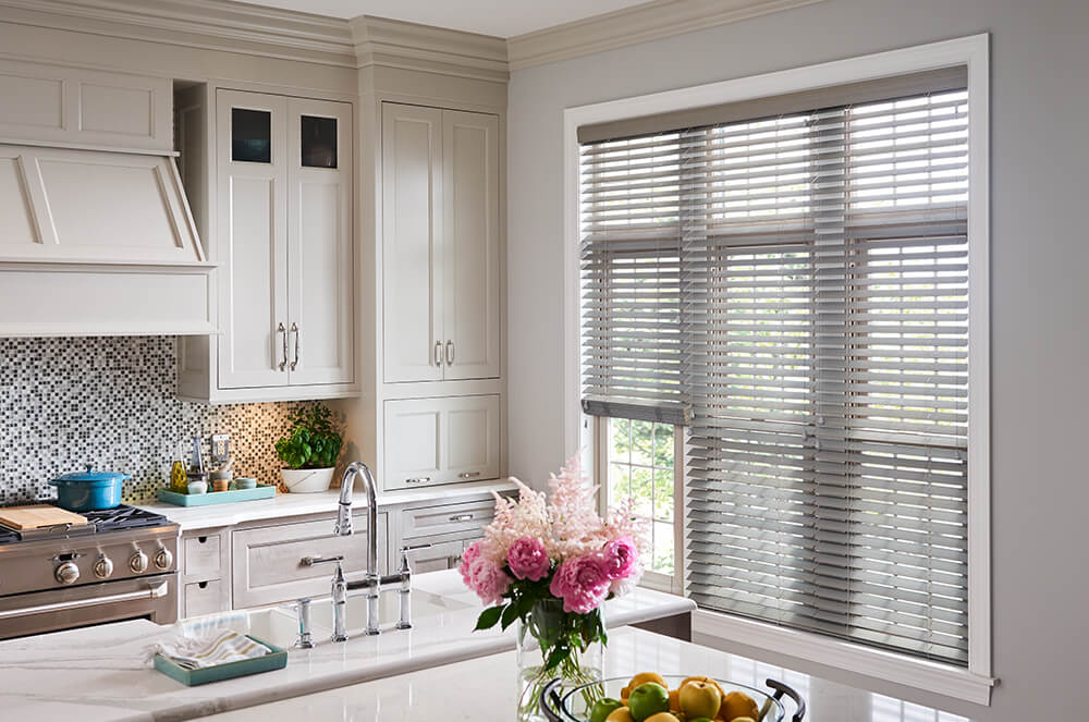 "2"" Wood Blinds    Add a modern flare to your home with custom made gray wood or faux wood blinds with a matching valance. Cordless lift for child and pet safety; wand tilt or breakaway tassel controls. Available in 2.5"" or 2"" slats."
