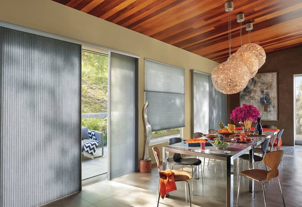 Vertical Honeycomb Shades    A vertical honeycomb slider shade tucks away tightly into the door frame and are a beautiful alternative to vertical blinds. With cellular shades being easy to operate and tucking away tightly, you won't be blocking your view outside.