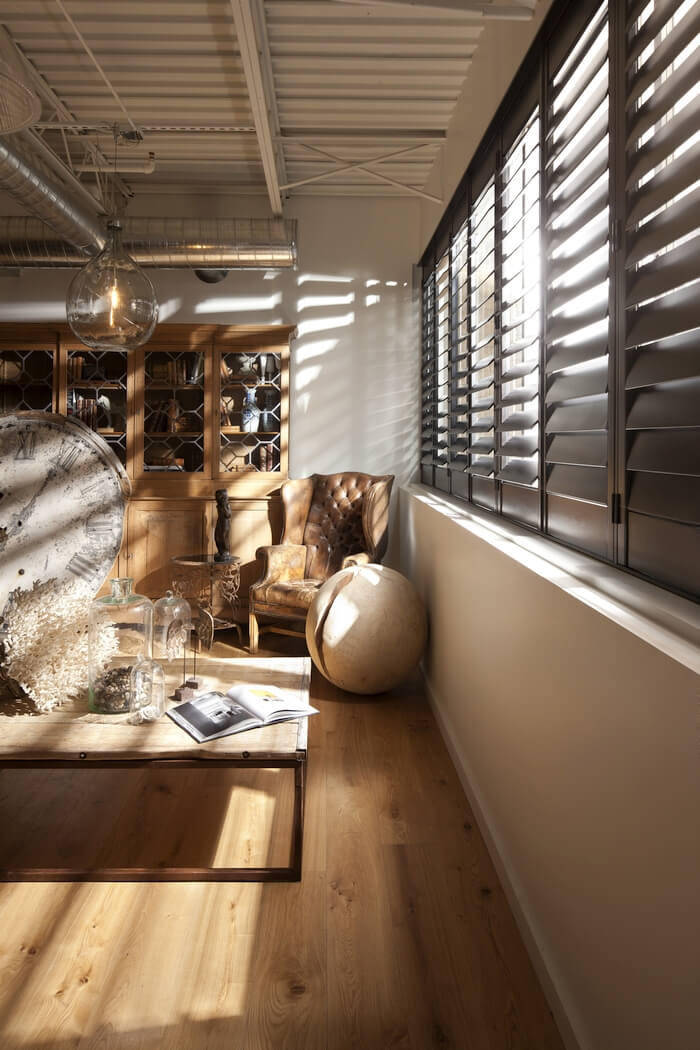 Composite Shutters    Norman composite shutters in a wood tone. A bold and beautiful statement window covering! Add motorization for a remote controlled shutter that is easy and convenient to operate.