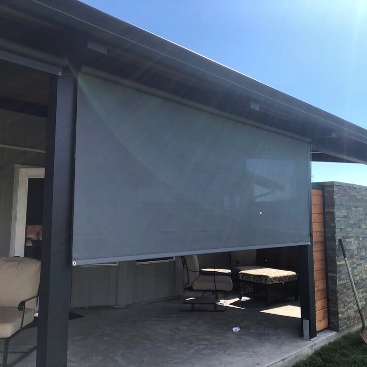 Exterior Solar Shade    Light filtering exterior roller shades reduce the suns glare and harmful UV rays so you can enjoy your outdoor patio.  (Olympia / Littlerock home)
