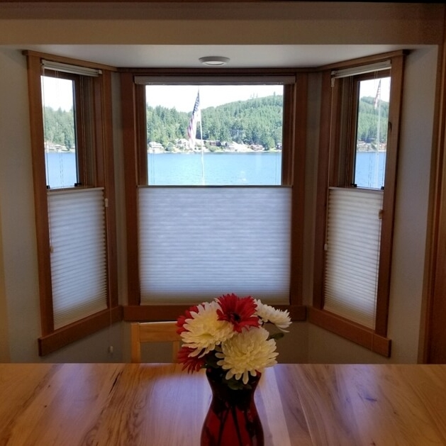 """Honeycomb Shades - Top Down Bottom Up    3/4"""" single cell honeycomb blinds with tassels (available in cordless) provide privacy while maintaining this gorgeous Summit Lake view in Olympia."""