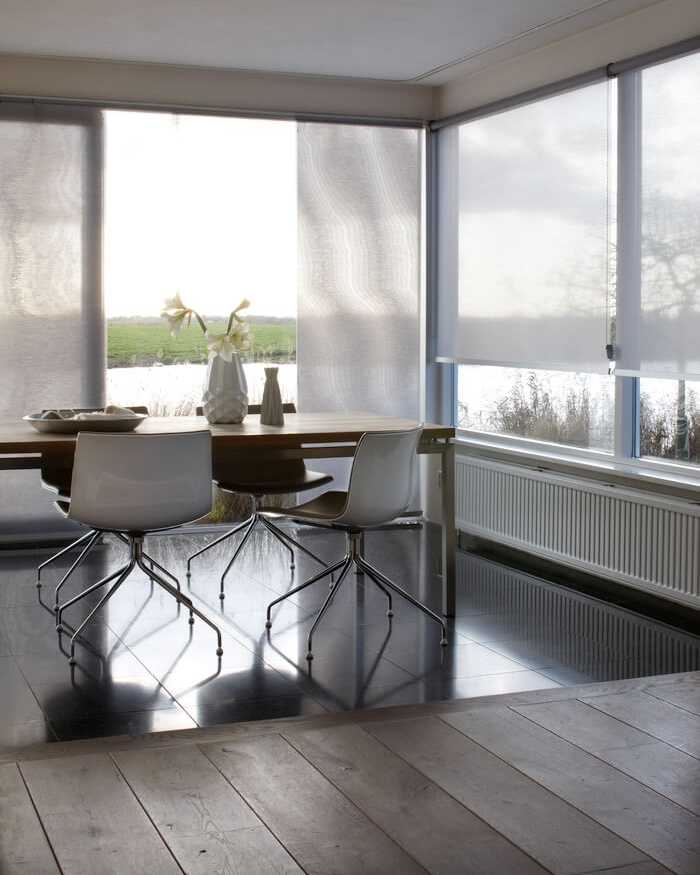 Solar Shades    Protect your sun room furniture and floors from harmful UV rays with light filtering solar shades. These are a great and modern alternative to vertical blinds for a slider.