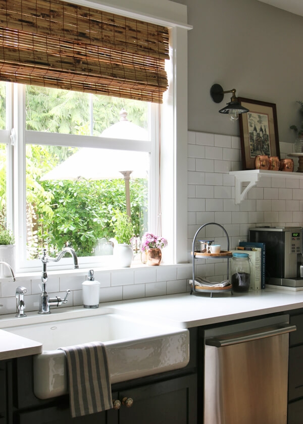 Woven Wood Roman Shades    Bamboo shades compliment modern farmhouse styles and add a touch of rustic style to a picture window.