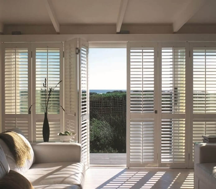 Bi-fold Shutters    Looking to cover a patio door or wide opening? Bi-fold shutters from Norman Window Fashions are a great, energy efficient option!
