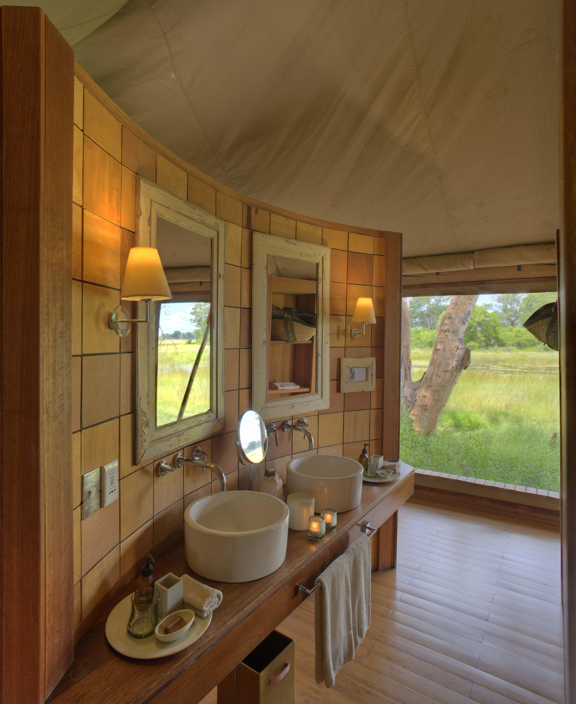 andBeyond-Xaranna-Okavango-Delta-Camp-Guest-Bathroom1.jpg