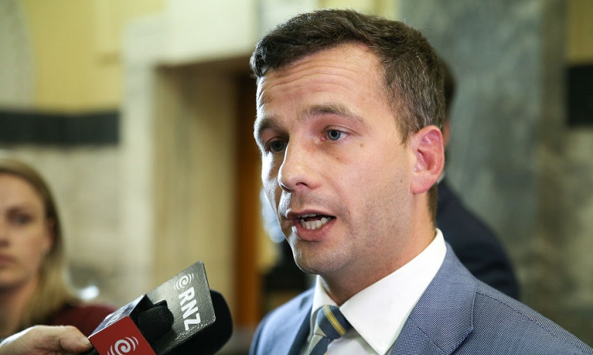 ACT leader David Seymour speaks to media on his way to the House at Parliament (Photo by Hagen Hopkins/Getty Images).