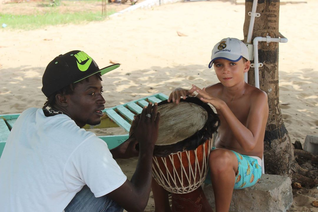 A drum lesson while hanging with the locals