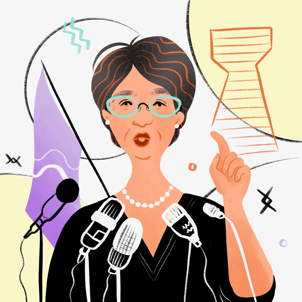 Illustration of an older woman with blue glasses, speaking in front of several microphones with her hand raised in the air.