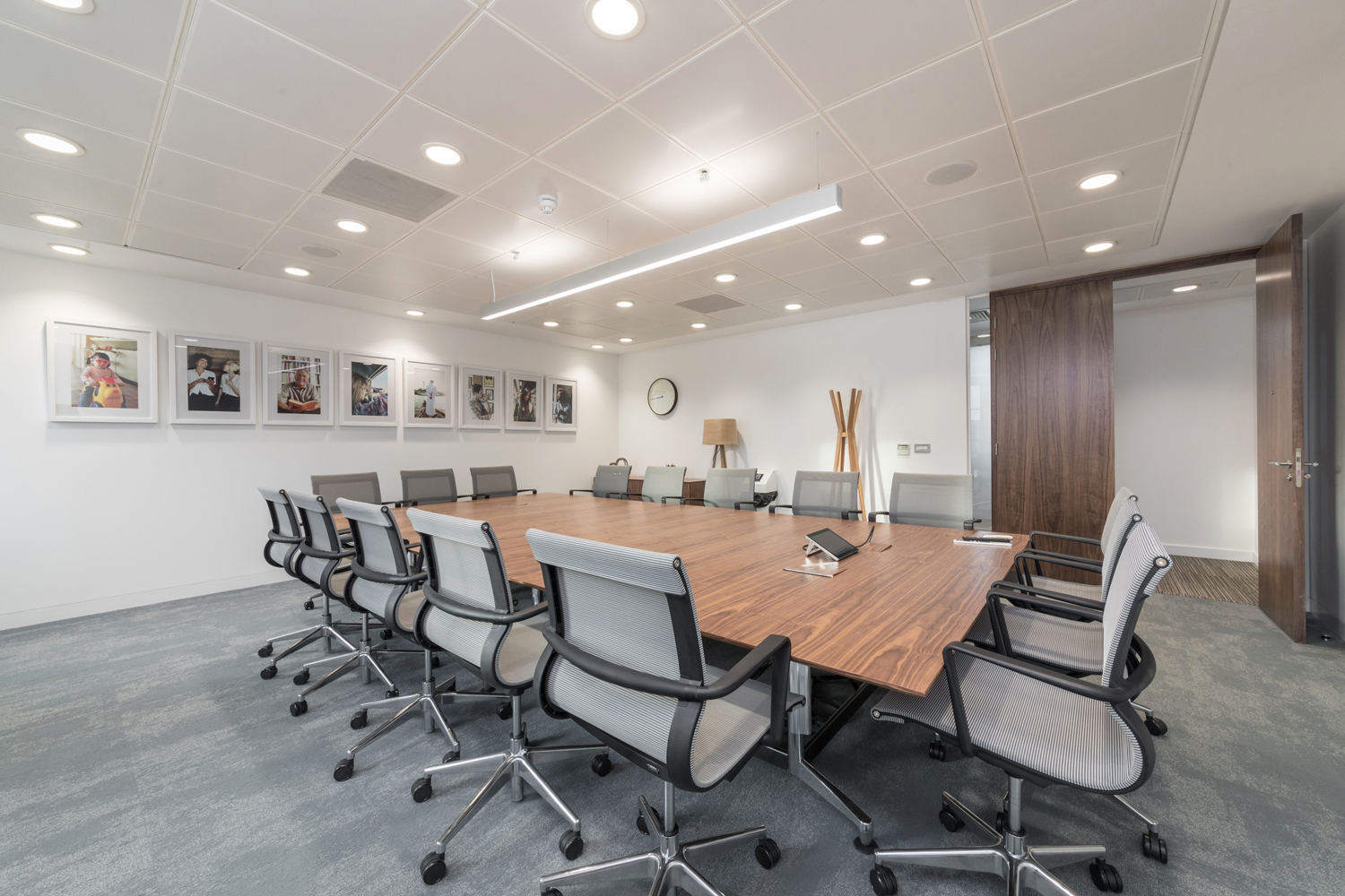 Meeting room with polished wood table and ergonomic chairs