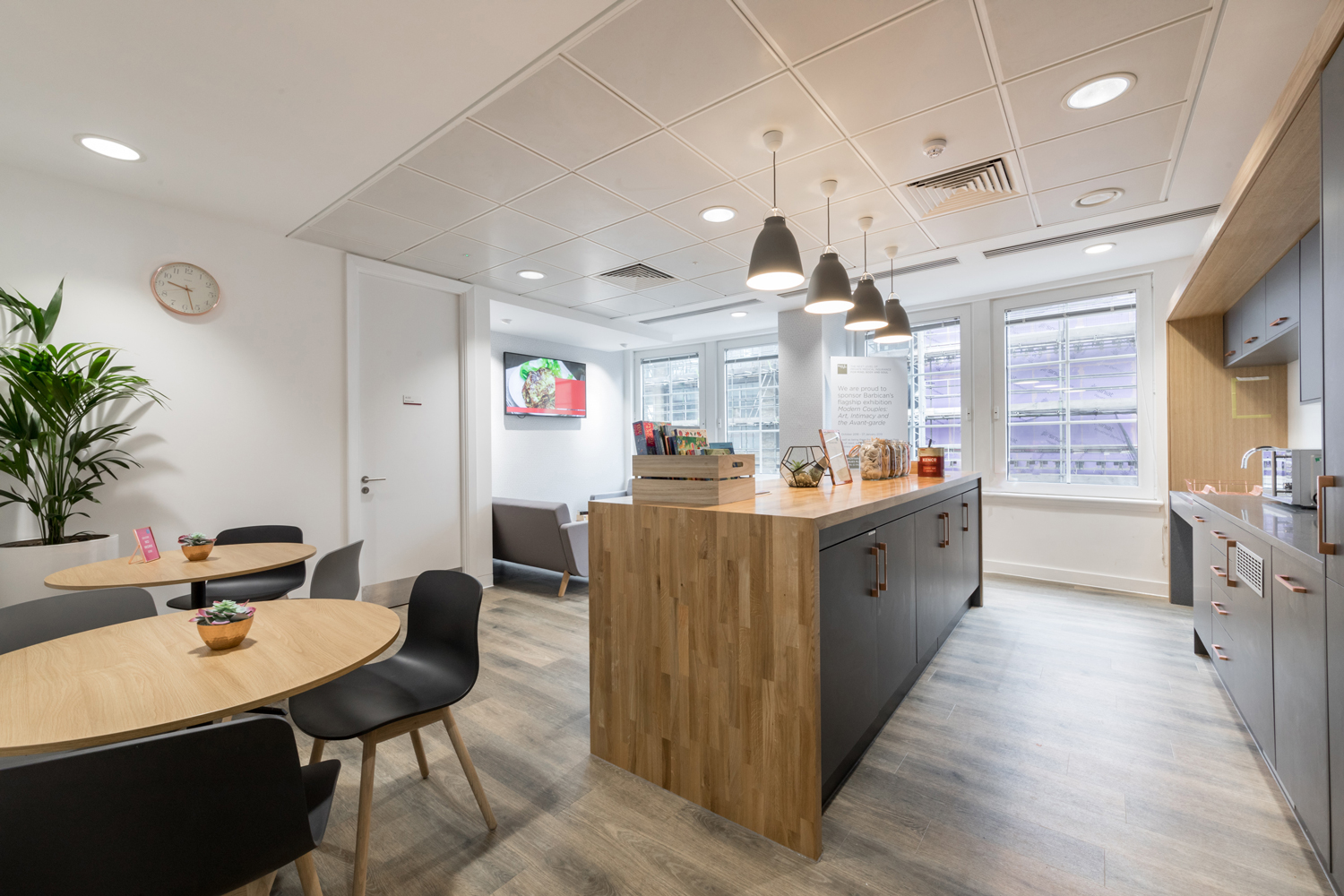 Modern kitchen with timber work surface, grey units and bronze handles