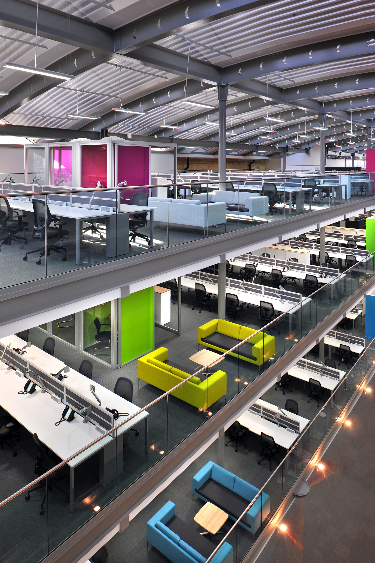 Blue, green and pink office furniture on different levels