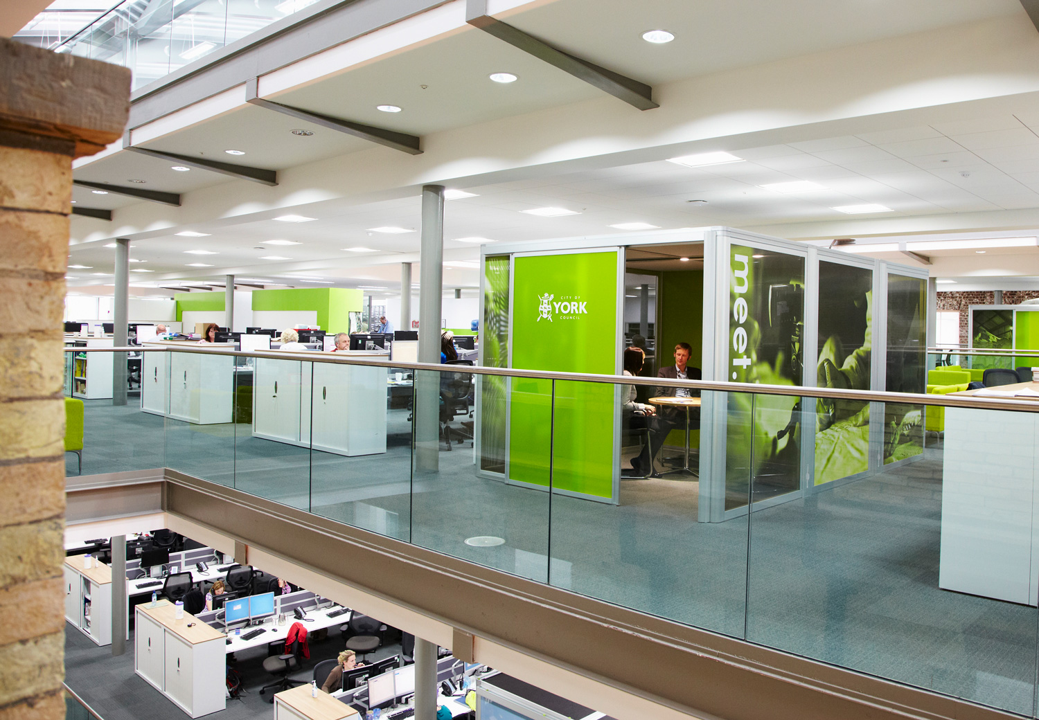 Bright green meeting pod with graphic glazing manifestation