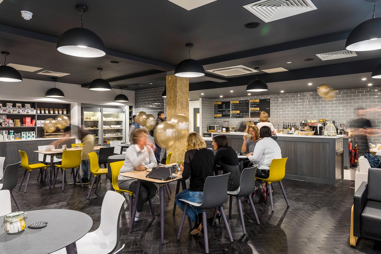 Black and yellow cafe with herringbone floor