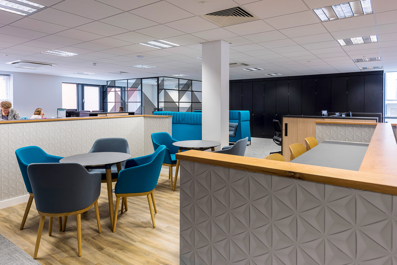 Office interior with blue chairs and feature wall