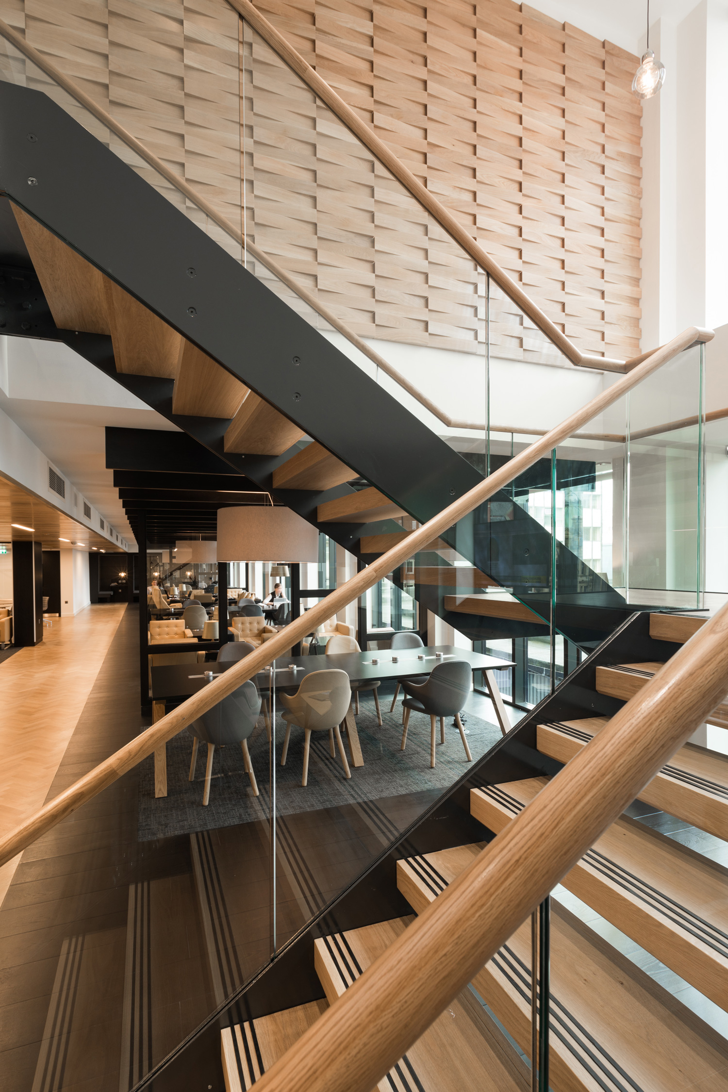 Office interior with timber and black staircase