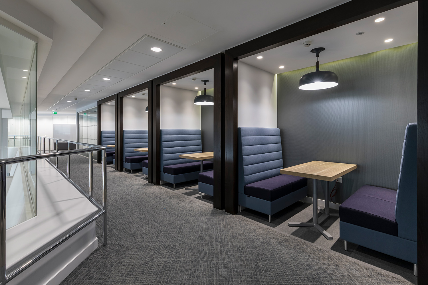 Private Breakout booths with blue and purple seating