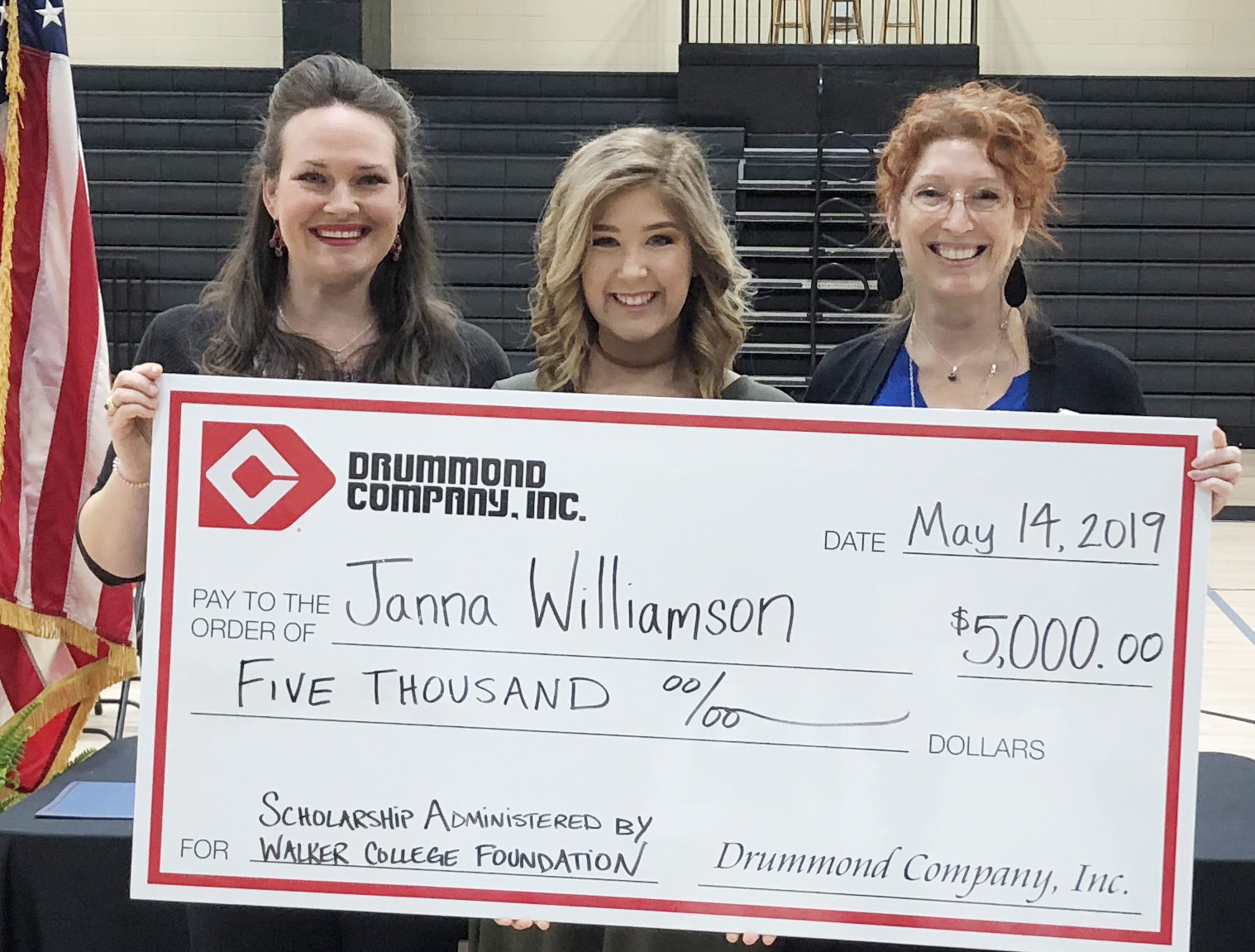 Janna Williamson (ctr) is awarded the Drummond Company scholarship by Drummond Company's Krystal Drummond (lt) and WCF's Holly Trawick (rt) at the Cleveland High School senior honors program.