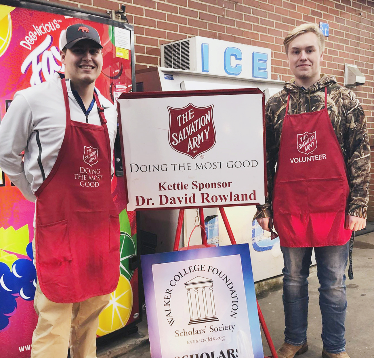 Zac and Tanner ring the bell for the Salvation Army.
