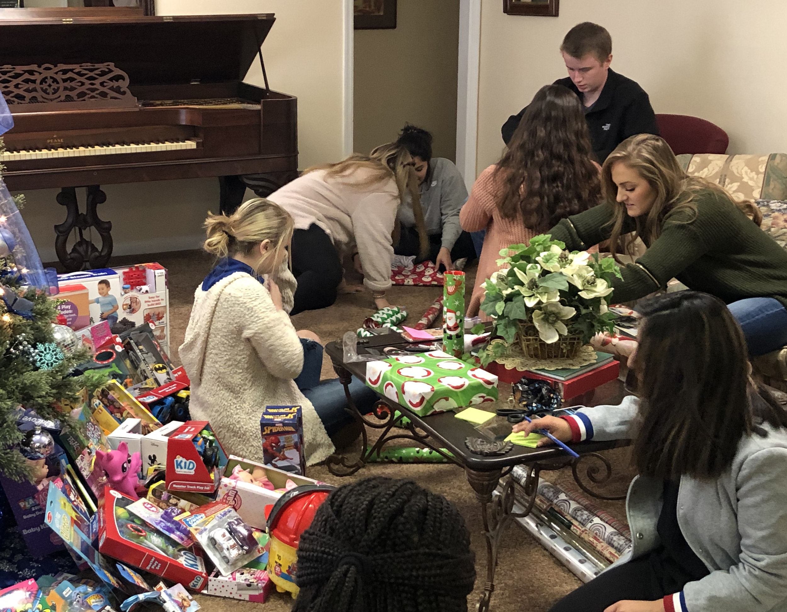 Scholars collected and wrapped toys in December 2018 for Capstone Rural Health Center clients.