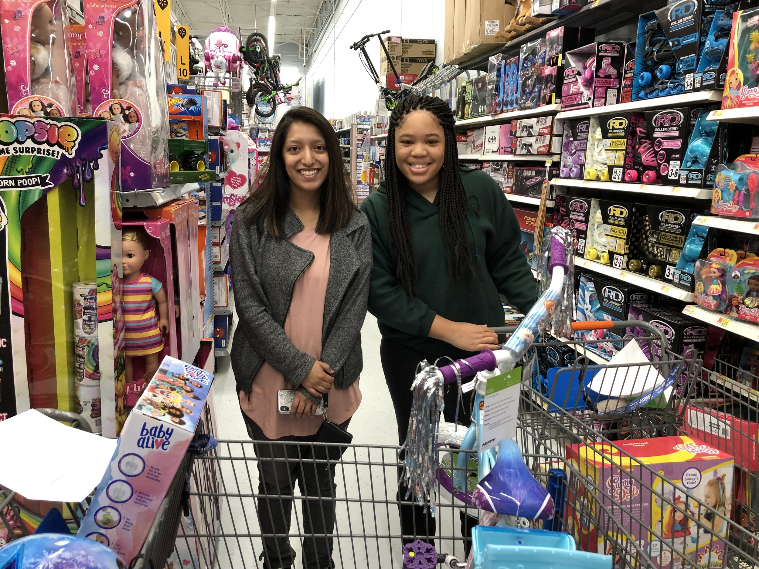 Silvana and Kalea shop for children's toys for Alabama Power-Plant Miller Service Organization's 2018 Operation Christmas Event.
