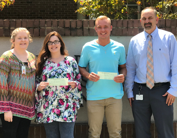 Emi Dutton and Jonah Trotter display 2018 ACEA scholarship checks with Allison Hadder (BSCC Math Instructor) and Dennis Willingham (WCBOE-Assistant Superintendant)