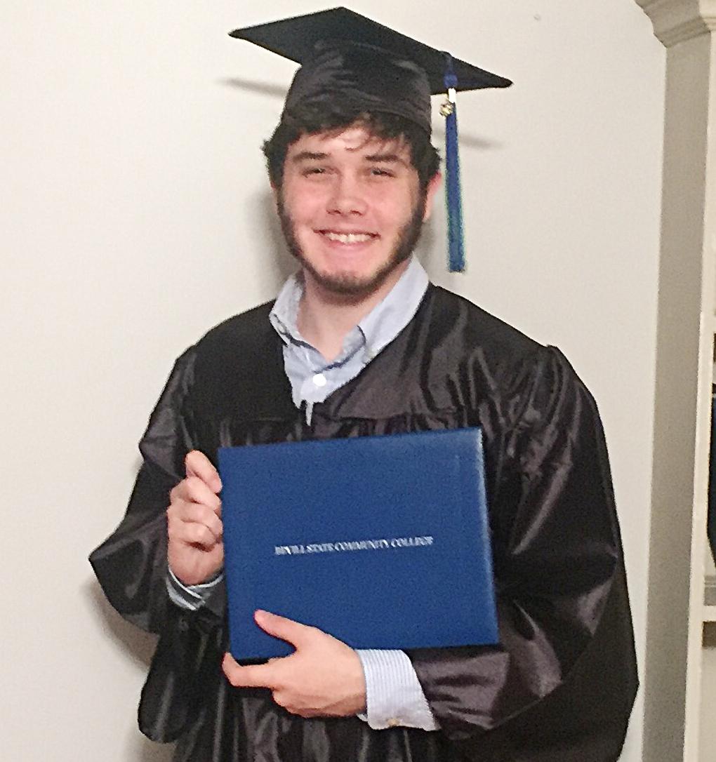 Trenton celebrates receiving his diploma!