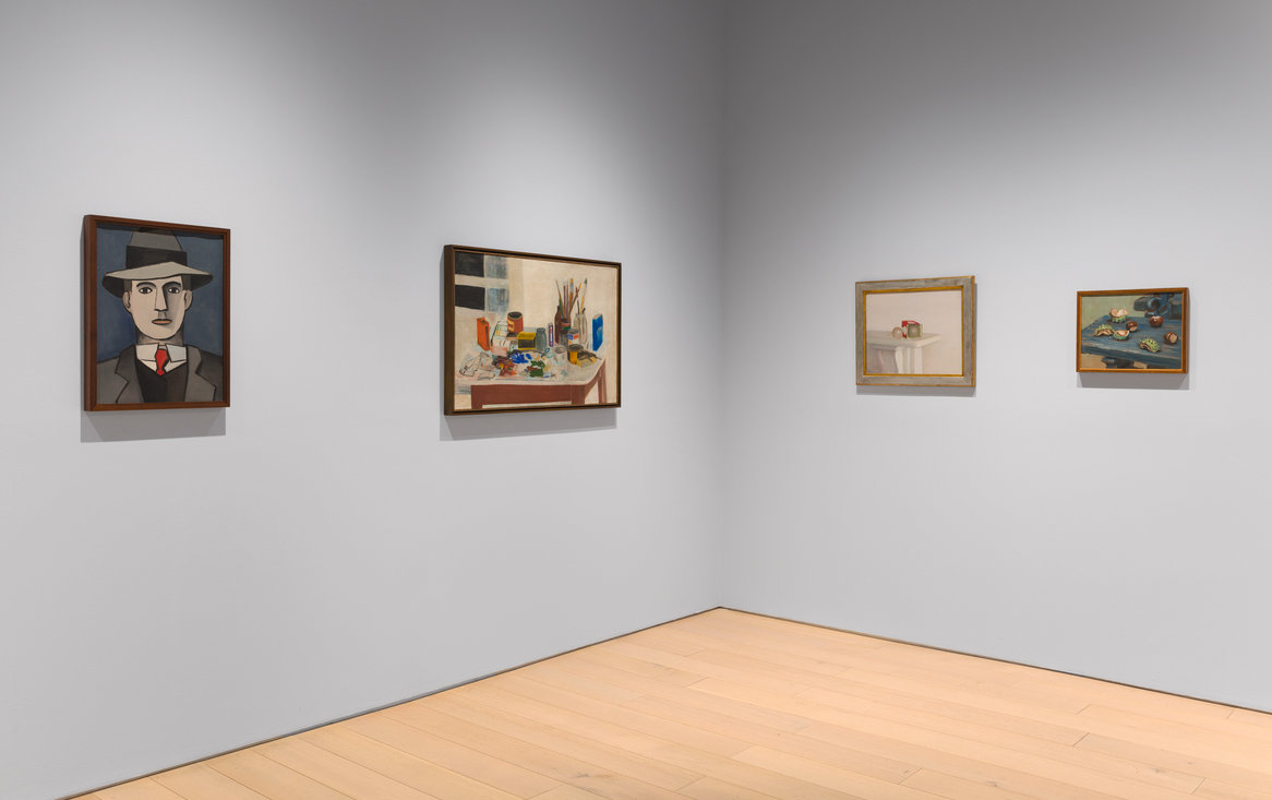 """FROM LEFT, JEAN HÉLION'S """"EDUARD,"""" (1943); JANE FREILICHER'S """"THE PAINTING TABLE"""" (1954); RODRIGO MOYNIHAN'S """"LIGHT BULBS"""" (1982); AND HÉLION'S """"UNTITLED (CHESTNUTS),"""" FROM 1955.  CREDITTHE ESTATE OF JOHN ASHBERY; DIEGO FLORES"""