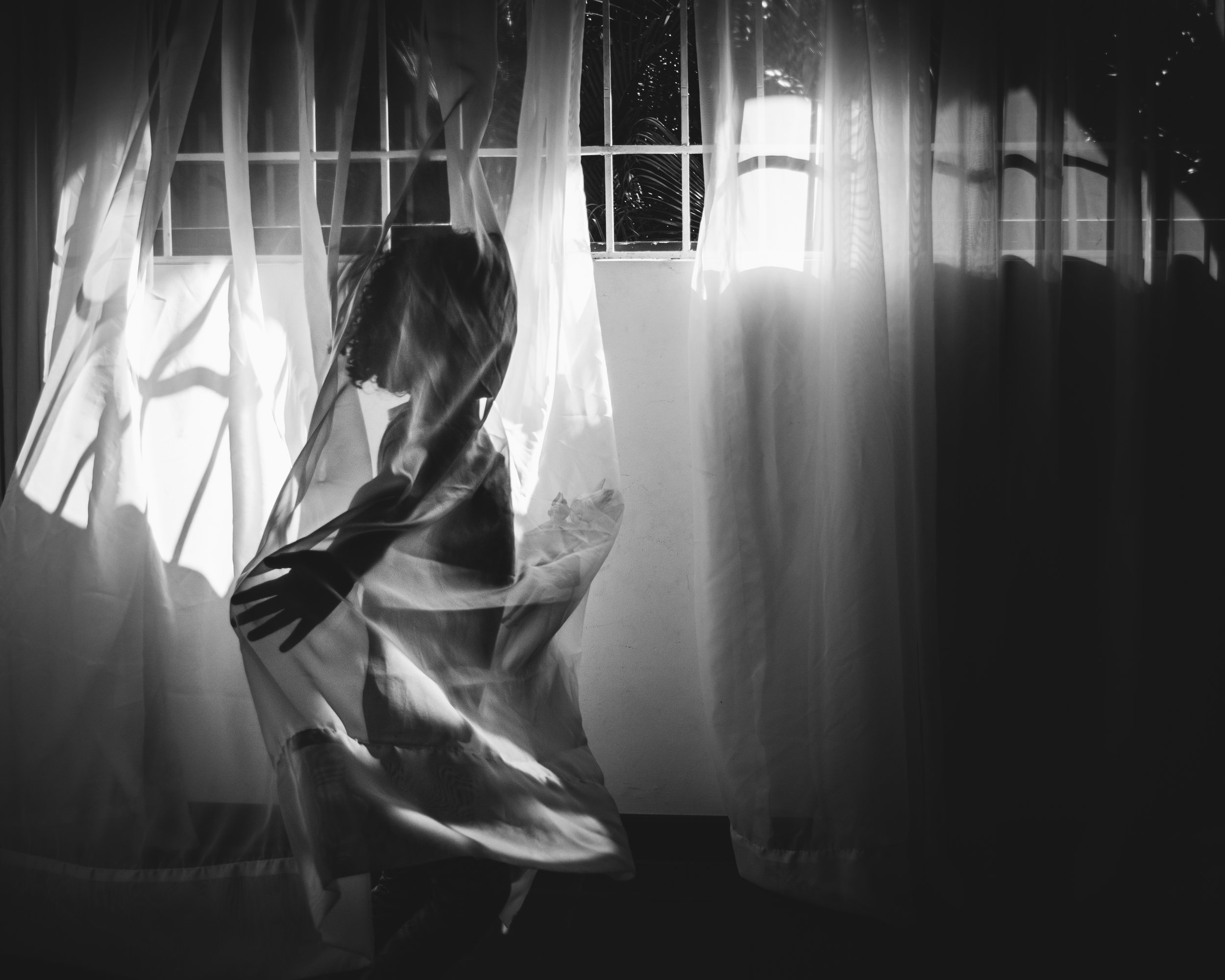 girl playing with curtain. Alicia Mayorca Photography | Chicago Couple + Maternity + Family Photographer.jpg