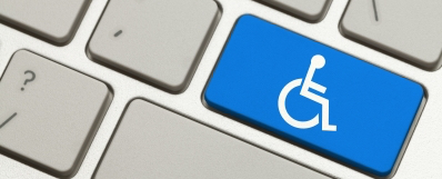Closeup illustration of a computer keyboard with one key blue with a white wheelchair symbol