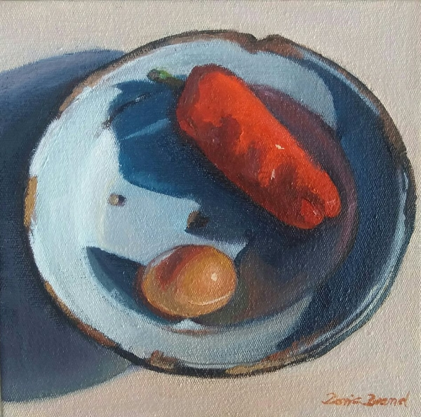 Red pepper and egg on old enamel plate