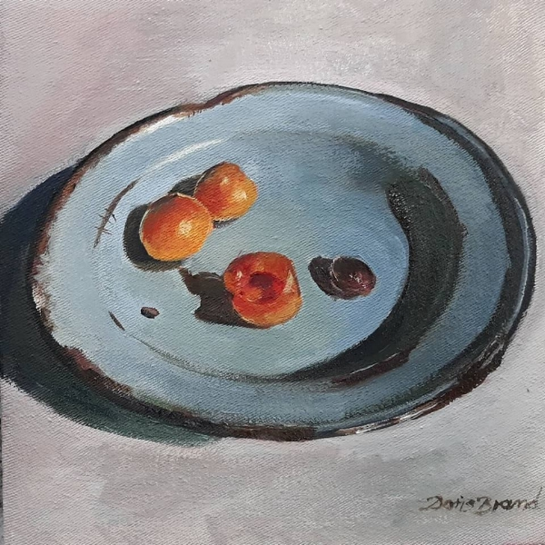Apricots in old enamel plate