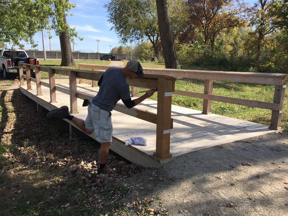 October 2016 - Task force volunteers stain bridge