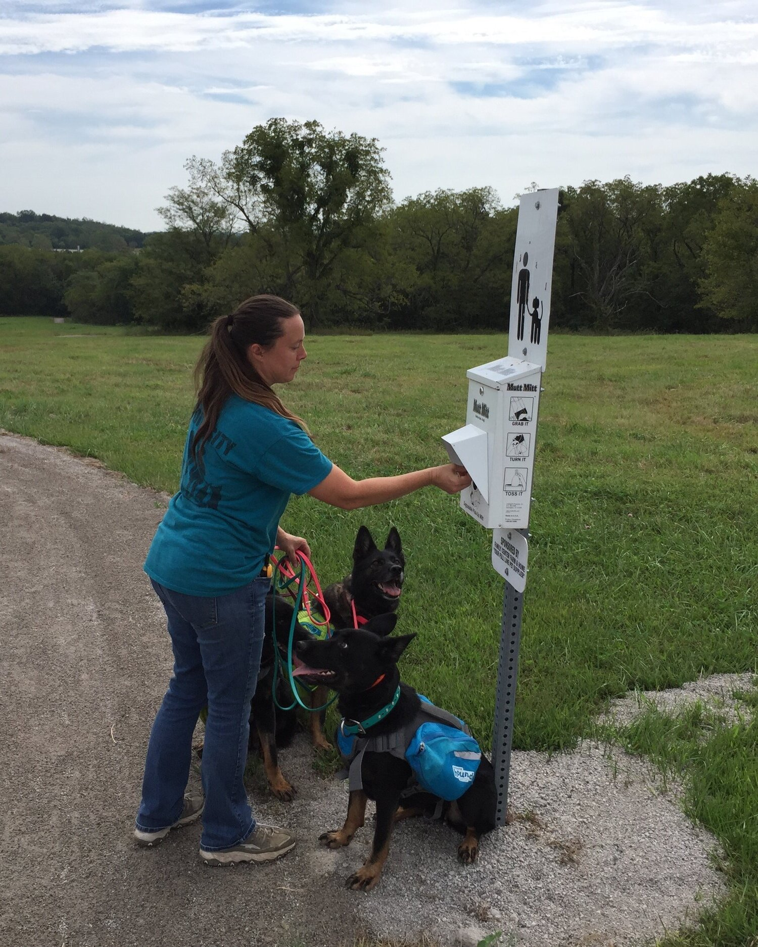 Conscientious dog owner prepares for a walk