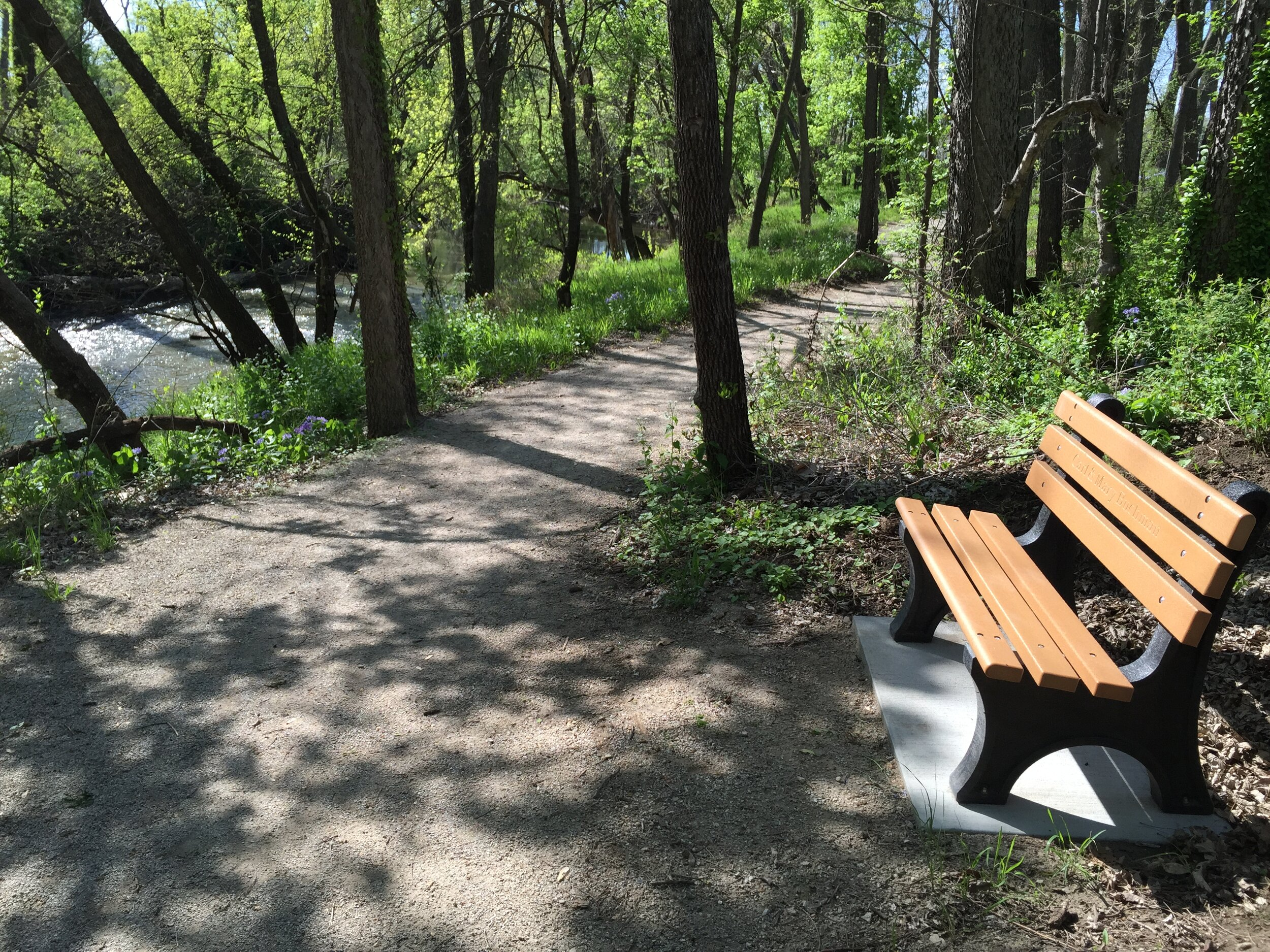 Sponsored benches provide places to relax and enjoy the scenery.