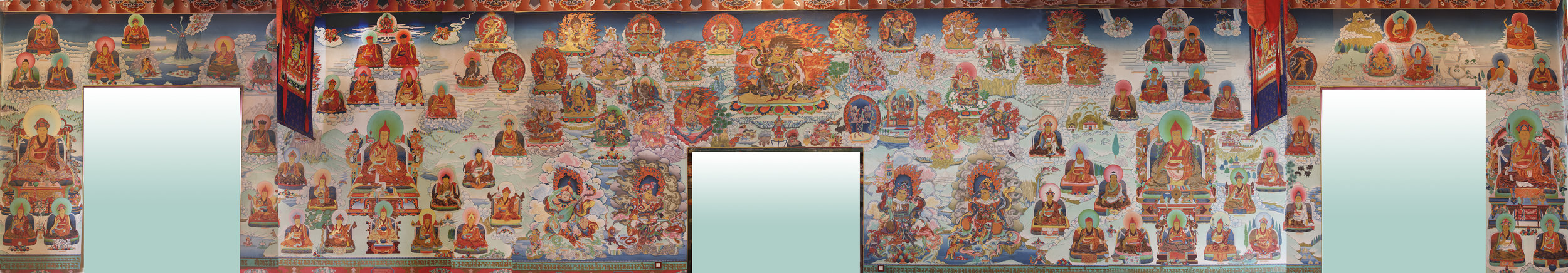 This wall has the most figures. Central figures include Shechen Gyaltsab Gyurme Namgyal (the teacher of Dilgo Khyentse Rinpoche), Jamgon Kongtrul Lodro Thaye, Jamyang Khyentse Wangpo, Gonpo Lhekden, and 2nd Rabjam Gyurme Kunzang Namgyal. Smaller figures include the 10th Trungpa Rinpoche, Situ Pema Wangchuk, 3rd Dodrup Chen Jigme Tenpei Nyima, Mipham Jamyang Gyalso, and Togden Shakya Shri.  The Four Kings will be painted above the main door of the temple and figures from Khyentse Rinpoche's treasure teachings (terma) will replace them on the East Wall.