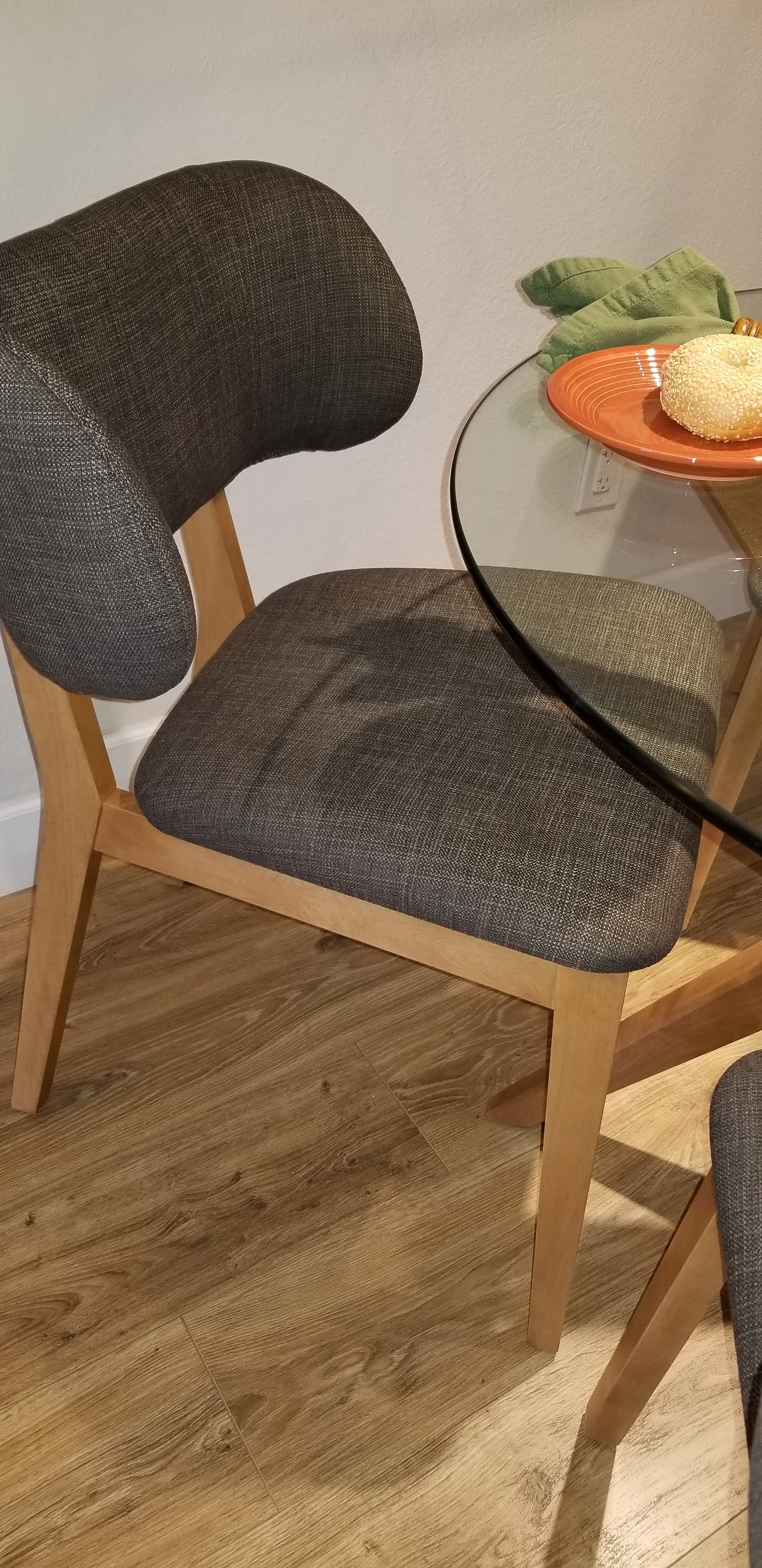 Dining chair in a charcoal woven fabric, mini wings on the back!