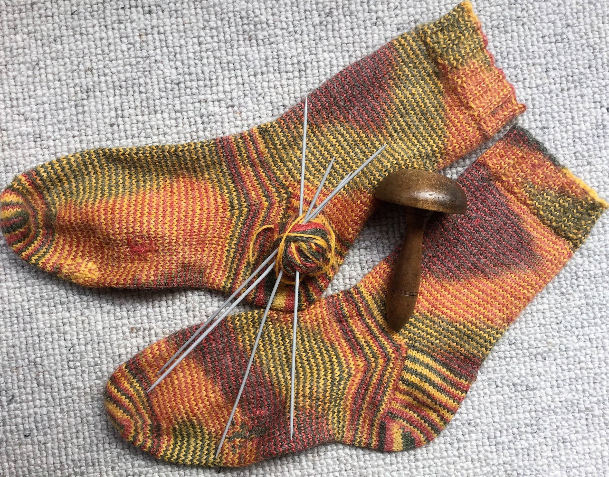 Orange socks with Olwyn's beloved darning mushroom.