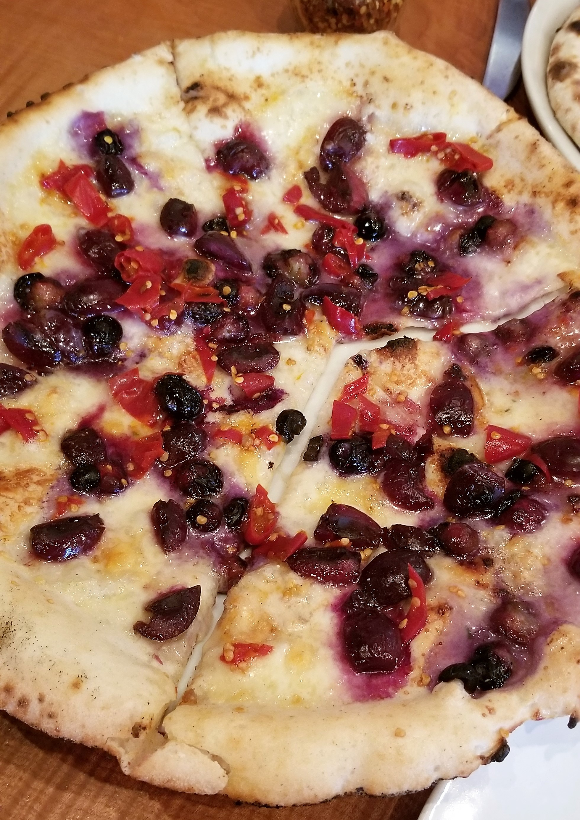 Seasonal pizza at Pizzeria Otto in Portland, blueberries, cherries, Calabrian chilis, tellegio cheese and gorgonzola!