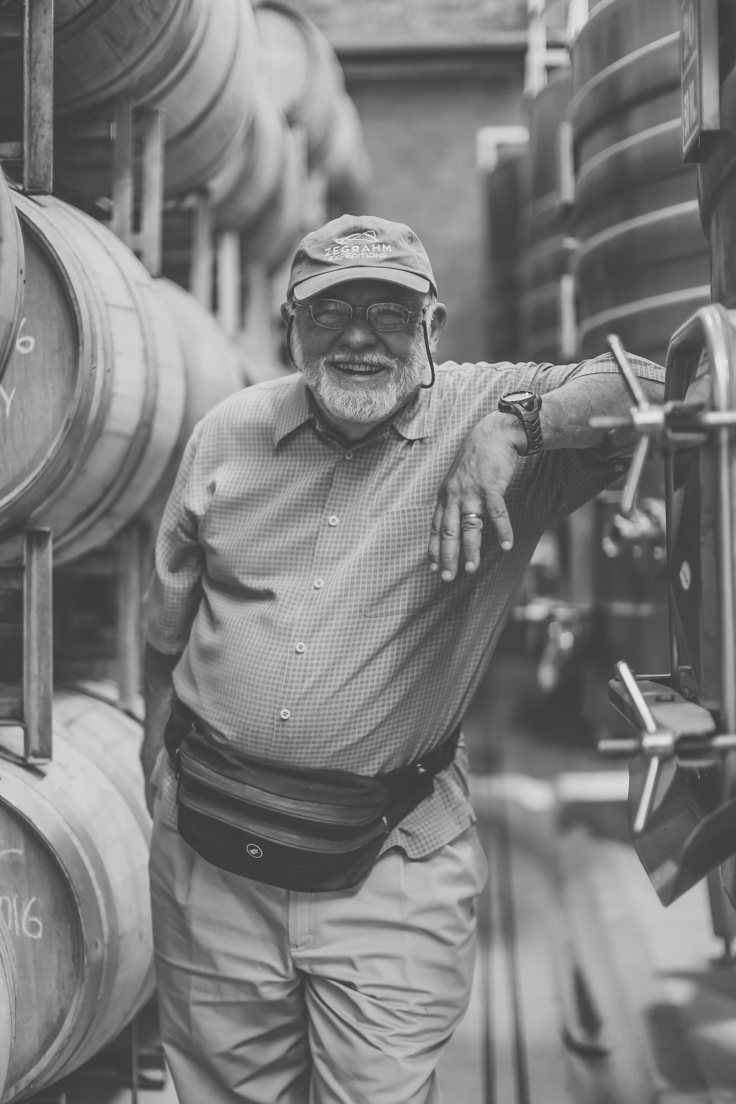 Owner, Wayne Tamarelli, infront of our once-used French-oak barrels.