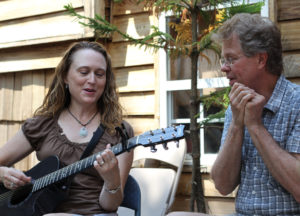Johnette-and-Scott-playing-music-at-Robbies-300x216.jpg