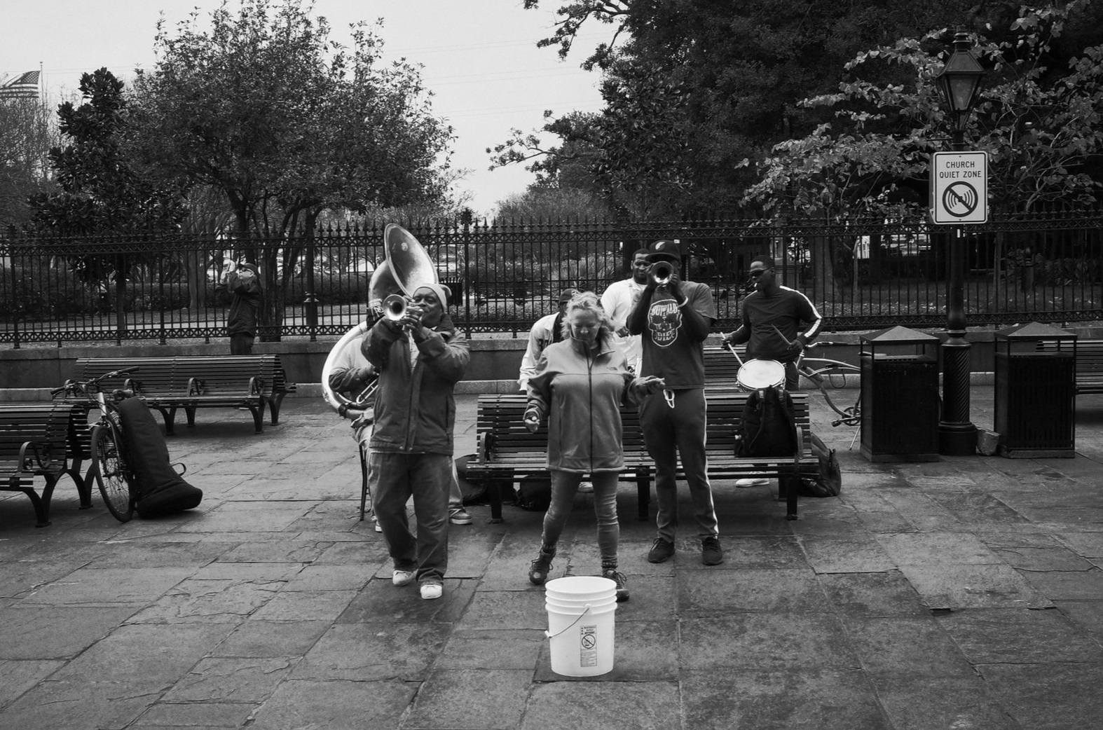 Musicians in Jackson Square, along with a tourist they recruited to participate. New Orleans. November 29, 2018